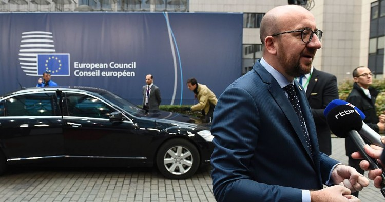 Belgium's Prime minister Charles Michel (R) addresses journalists as he arrives for the second day of an European Union leaders summit to discuss Syria, relations with Russia, trade and migration, on October 21, 2016 at the European Council, in Brussels