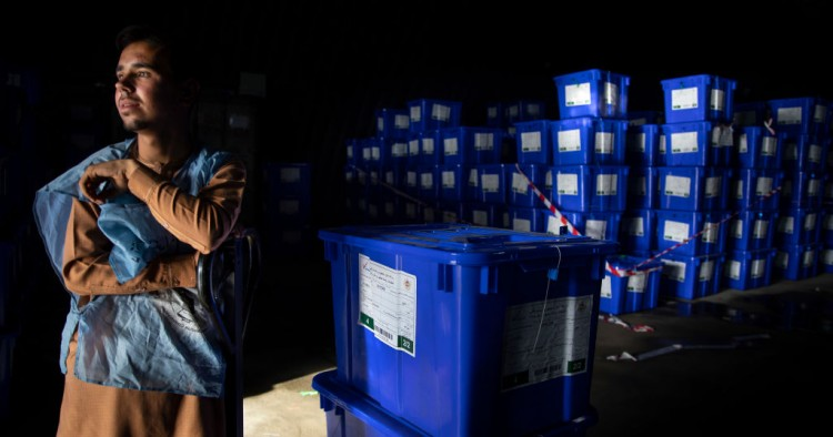 Afghan workers move ballot boxes to trucks getting ready for the Presidential elections in five days in Kabul, Afghanistan on September 23, 2019.