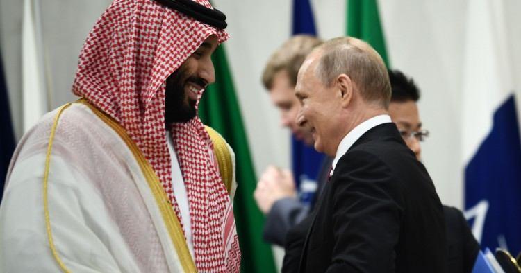 Saudi Arabia's Crown Prince Mohammed bin Salman and Russia's President Vladimir Putin attend a meeting at the G20 Summit in Osaka on June 28, 2019. (Photo by Brendan Smialowski / AFP) (Photo credit should read BRENDAN SMIALOWSKI/AFP/Getty Images)