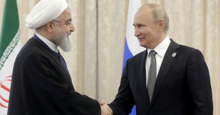 Iran's President Hassan Rouhani (L) and Russia's President Vladimir Putin shake hands as they meet on the sidelines of a meeting of the Shanghai Cooperation Organisation (SCO) Council of Heads of State.