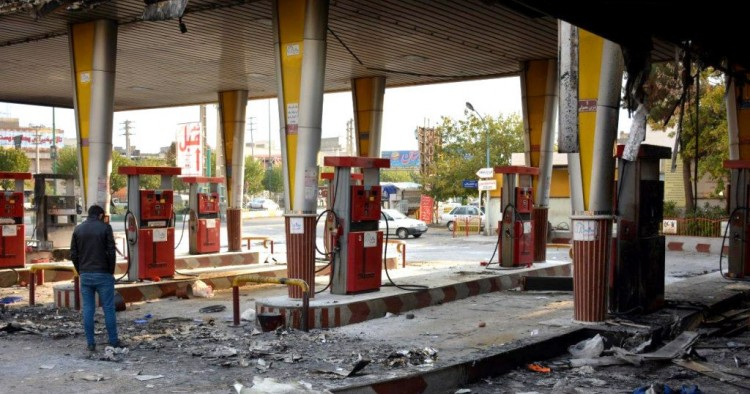 An Iranian man checks a scorched gas station that was set ablaze by protesters during a demonstration against a rise in gasoline prices in Eslamshahr, near the Iranian capital of Tehran, on November 17, 2019.