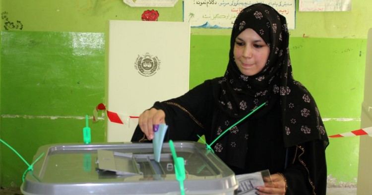 Afghan woman casts his vote at a polling station during the presidential elections in Kabul, Afghanistan on September 28, 2019.
