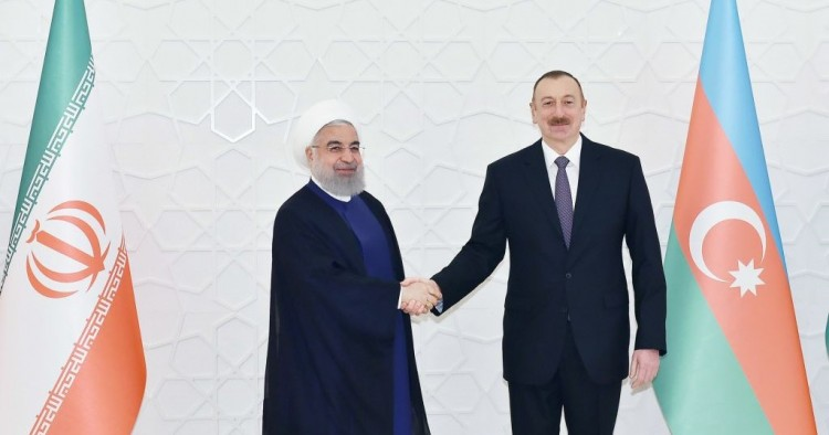Iranian President Hassan Rouhani (L) meets President of Azerbaijan Ilham Aliyev (R) during his official visit in Baku, Azerbaijan on March 28, 2018.