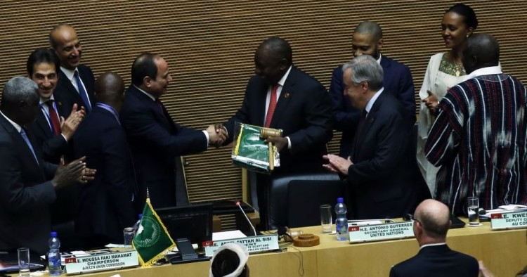 South African President Cyril Ramaphosa (5th R) assumes gavel for a year-long African Union (AU) presidency from the outgoing Abdel-Fattah El-Sisi (5th L), the Egyptian president, during the 33rd African Union Heads of State Summit in Addis Ababa, Ethiopia on February 09, 2020.