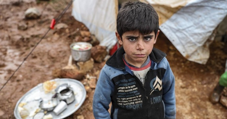 Syrian child poses at a camp hosting Syrian families, who have been forced to displace due to the attacks carried out by Assad regime and Russia, in Idlib, Syria on January 10, 2020.