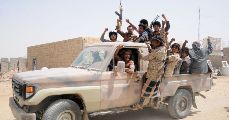 Houthi fighters gather on a vehicle in a recently captured area following heavy fighting with forces loyal to the internationally recognized government on March 2, 2020 in Al-Jawf province, Yemen.