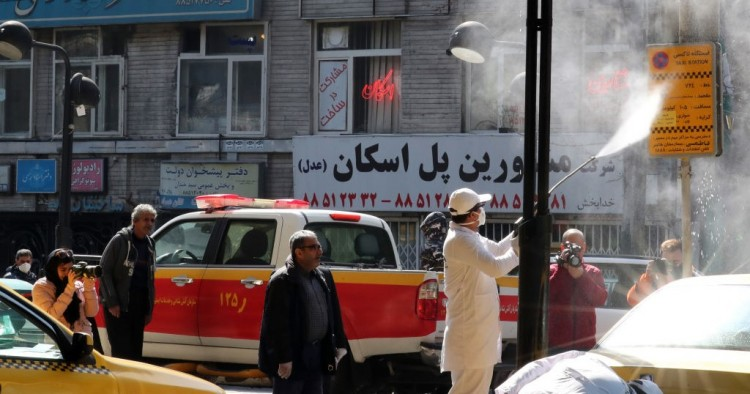 Iranian fire fighters and municipality workers disinfect a street in the capital Tehran for corona virus COVID-19 on March 5, 2020.