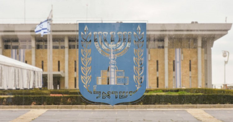 An emblem of Israel with the Knesset in the background, seen on the day of Israeli Legislative Elections 2020, in Central Jerusalem.
