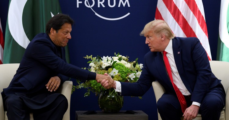US President Donald Trump (R) shakes hands with Pakistani Prime Minister Imran Khan ahead of their meeting at the World Economic Forum in Davos, on January 21, 2020. (Photo by JIM WATSON / AFP) (Photo by JIM WATSON/AFP via Getty Images)