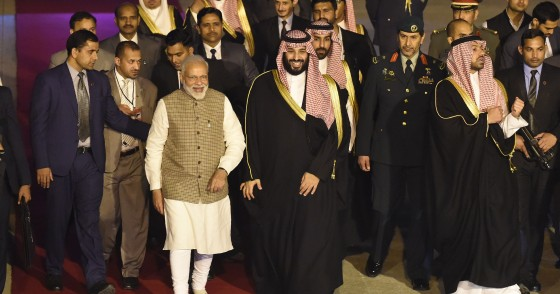 Saudi Crown Prince Mohammed bin Salman walks next to Indian Prime Minister Narendra Modi upon arriving at the airport in New Delhi on February 19, 2019.