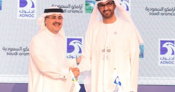 Sultan Ahmed al-Jaber(R), the director general and CEO of ADNOC, shakes hands with Saudi Aramco CEO Amin Nasser after signing a cooperation deal in Abu Dhabi on November 12, 2018.