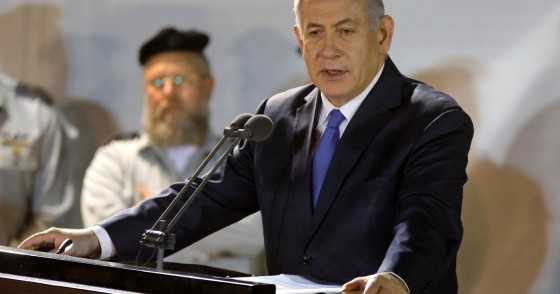 Prime Minister Benjamin Netanyahu (R) attends the funeral of Sergeant First Class Zachary Baumel at the Mount Herzl military cemetery in Jerusalem on April 4 2019.