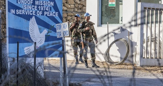 UNDOF forces stand guard at the entrance to the UN headquarters, in the demilitarized zone, near the Quneitra border crossing in the Israeli annexed Golan Heights on September 5, 2014