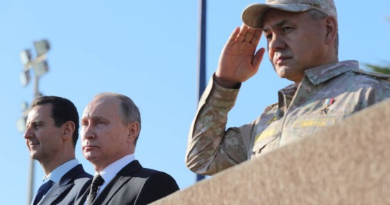 Syria's President Bashar al-Assad, Russia's President Vladimir Putin, and Russia's Defence Minister Sergei Shoigu (L-R) at the Russian Hmeimim air base.