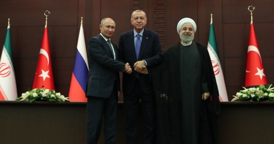 President of Turkey Recep Tayyip Erdogan (C), President of Russia Vladimir Putin (L) and President of Iran Hassan Rouhani (R) shake hands as they pose for a photo after a joint press conference following the Turkey-Russia-Iran trilateral summit at Cankaya Mansion in Ankara, Turkey on September 16, 2019.
