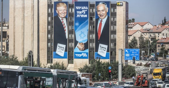 A general view of an election campaign banner depicting Israeli Prime Minister Benjamin Netanyahu (R), head of the Likud Party, shaking hands with US President Donald Trump, ahead of the snap Israeli legislative election, scheduled to take place on 17 September 2019
