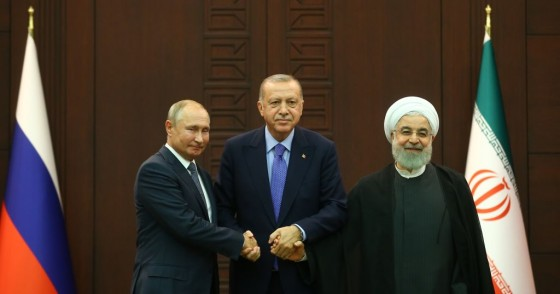 President of Turkey Recep Tayyip Erdogan (C), President of Russia Vladimir Putin (L) and President of Iran Hassan Rouhani (R) pose for a photo after the joint press conference held within the Turkey-Russia-Iran trilateral summit at Cankaya Mansion in Ankara, Turkey on September 16, 2019.