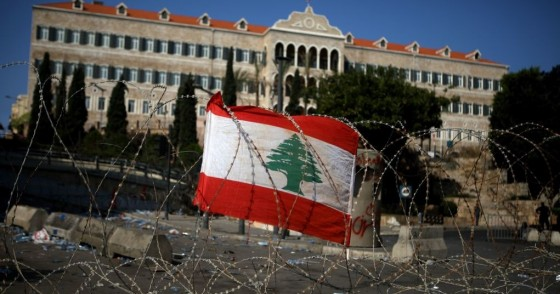 A Lebanese national flag fixed on barbed wire protecting the government headquarters, known as the Grand Serail, in central Beirut.