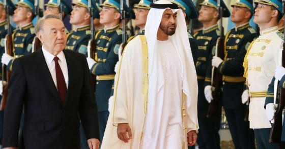 Abu Dhabi Crown Prince Mohammed bin Zayed al-Nahayan (R) reviews an honour guard with Kazakhstan's President Nursultan Nazarbayev during a welcoming ceremony in Astana on July 4, 2018.