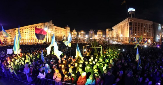People attend a rally marking the 6th anniversary of the 2014 Euromaidan antigovernment riots at Kiev's Independence Square.