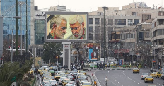 A billboard bearing a portrait with the black mourning ribbon of slain Iranian military commander Qasem Soleimani (L) and Iraqi paramilitary chief Abu Mahdi al-Muhandis hangs on a main road in the Iranian capital Tehran on January 4, 2020, one day after Soleimani and other members of the pro-Iranian Iraqi paramilitary group Al-Hashed Al-Shaabi were killed in a US air strike near Baghdad international airport.