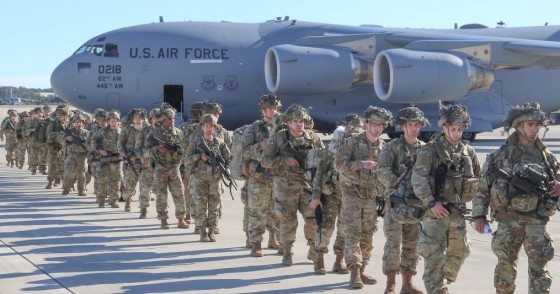 U.S. Army Paratroopers assigned to the 2nd Battalion, 504th Parachute Infantry Regiment, 1st Brigade Combat Team, 82nd Airborne Division, deploy from Pope Army Airfield, North Carolina on January 1, 2020.