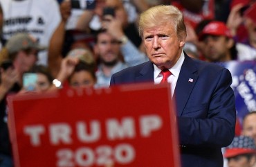 US President Donald Trump looks on during a rally at the Amway Center in Orlando, Florida to officially launch his 2020 campaign on June 18, 2019.