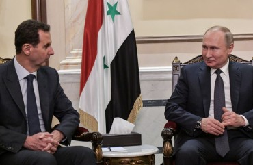 Syria's President Bashar al-Assad (L) and Russia's President Vladimir Putin during a meeting in the Cathedral of Our Lady of the Dormition.