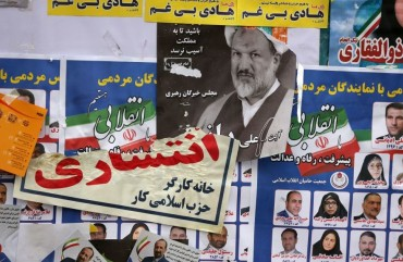 Iranian electoral posters and fliers are pictured on the last day of election campaign in Tehran on February 19, 2020.