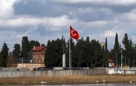 Turkish flag hangs at border with Syria