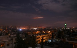 Syrian air defense batteries responding to Israeli missiles targeting Damascus