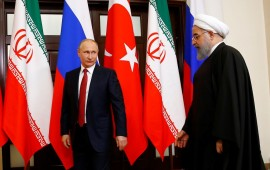 Russian President Vladimir Putin (L) and Iranian President Hassan Rouhani (R) attend the trilateral summit to discuss progress on Syria, between the Presidents of Turkey, Russia and Iran on November 22, 2017 in Sochi, Russia.