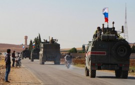 A convoy of Russian military vehicles drives toward the northeastern Syrian city of Kobane on October 23, 2019.