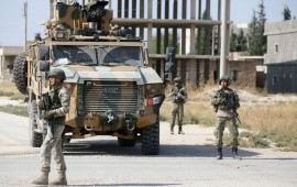 Turkish soldiers patrol the northern Syrian Kurdish town of Tal Abyad, on the border between Syria and Turkey, on October 23, 2019
