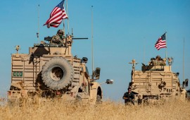 A convoy of US military vehicles drives near the town of Tal Tamr in the northeastern Syrian Hasakeh province on the border with Turkey, on November 10, 2019.