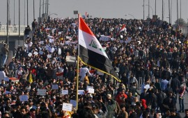 Iraqi students, waving national flags, join anti-government protests in the Shiite shrine city of Najaf in central Iraq on January 28, 2020.