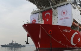 A picture taken at the port of Dilovasi, outside Istanbul, on June 20, 2019 shows the drilling ship 'Yavuz' scheduled to search for oil and gas off Cyprus, next to a warship.