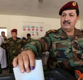 A member of the Kurdish Peshmerga force casts his ballot in special voting ahead of Iraq's upcoming election on April 28, 2014, in the northern Iraqi Kurdish city of Erbil
