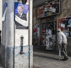 Man walks past an election campaign poster of Algerian president and presidential candidate Abdelaziz Bouteflika at Bab El Oued district in Algiers