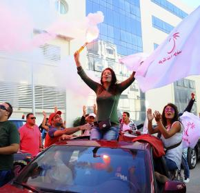 Supporters of Tunisian party Nida Tunis (Tunisia Calls) celebrate their victory in parliamentary elections in Tunis, Tuesday, Oct.28, 2014.