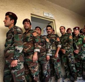 Members of the Kurdish Peshmerga force wait to cast their ballots ahead of Iraq's upcoming election on April 28, 2014, in the northern Iraqi Kurdish city of Erbil
