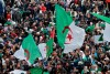 Algerian protesters wave national flags during an anti-government demonstration in the capital Algiers, on December 20, 2019.